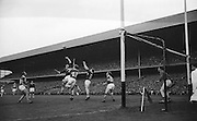 Galway's C. Tryell jumps for the ball during the All Ireland Senior Gaelic Football Final Kerry v. Galway in Croke Park on the 26th September 1965. Galway 0-12 Kerry 0-09.