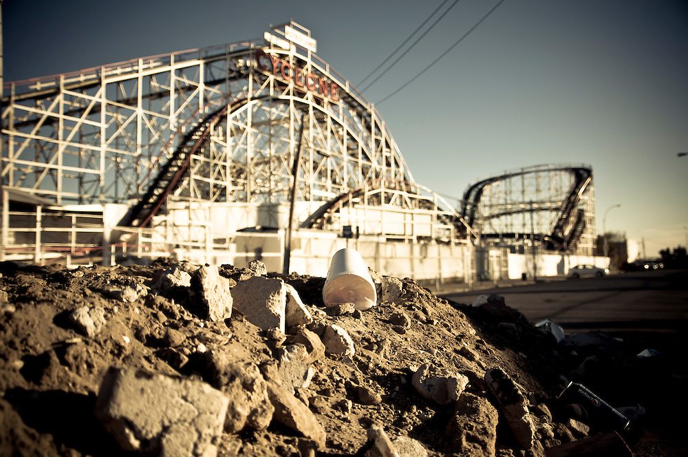 A pile of dust and garbage next to the Cyclone roller coaster in Coney Island, Brooklyn, New york, 2010.