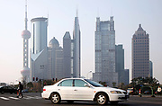 A Honda vehicle travels through the Lujiazui Financial District  in Shanghai, China, on Monday, 31 January 2011.