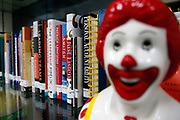 Inspirational leadership books sit on a shelf at the McDonalds Hamburger University in Shanghai, China on Thursday, 13 january 2011.  McDonalds claim that the university's selection criteria is even more stringent than that of Harvard.