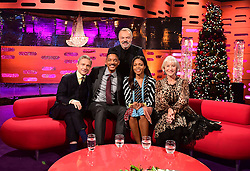 Host Graham Norton (back row) with (left to right) Martin Freeman, Will Smith, Naomie Harris and Dame Helen Mirren during filming of the Graham Norton Show filmed at the London Studios. London, which will be transmitted on BBC One on December 23.