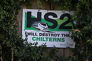 An anti-HS2 sign is displayed outside a private residence on 30th July 2020 in Butler's Cross, United Kingdom. There is widespread opposition to the controversial £106bn HS2 high-speed rail link project in the Chilterns, an Area of Outstanding Natural Beauty AONB.