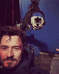 """Orlando Bloom releases a photo on Instagram with the following caption: """"last selfie on a set in my 41st year \ud83c\udf82...i\u2019m grateful and as I contemplate the passage of time I really feel age is just a number and we are not...we ARE the choices we make, the words we speak, the thoughts we create and the actions we take...they shape our realities...and as I say to myself and my son...make smart choices...happy me \u2b55\ufe0fand my loyal companion"""". Photo Credit: Instagram *** No USA Distribution *** For Editorial Use Only *** Not to be Published in Books or Photo Books ***  Please note: Fees charged by the agency are for the agency's services only, and do not, nor are they intended to, convey to the user any ownership of Copyright or License in the material. The agency does not claim any ownership including but not limited to Copyright or License in the attached material. By publishing this material you expressly agree to indemnify and to hold the agency and its directors, shareholders and employees harmless from any loss, claims, damages, demands, expenses (including legal fees), or any causes of action or allegation against the agency arising out of or connected in any way with publication of the material."""