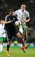 Steven Fletcher of Scotland tussles with John O'Shea of Ireland - UEFA Euro 2016 Qualifier - Scotland vs Republic of Ireland - Celtic Park Stadium - Glasgow - Scotland - 14th November 2014  - Picture Simon Bellis/Sportimage
