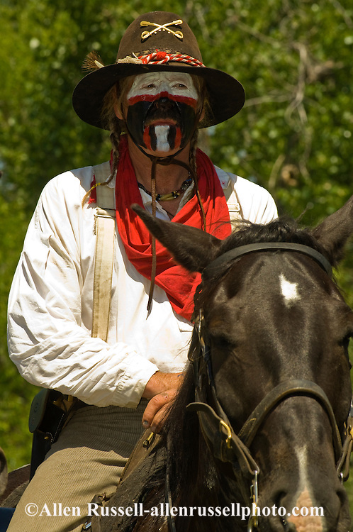 Custers Last Stand Reenactment, Battle of the Little Bighorn, Crow Indian Reservation, Montana, 7th Cavalry scout with war paint, <br /> MODEL RELEASED