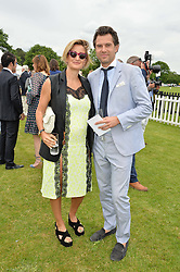 ZOE JORDAN and her husband STEVE ASPINALL at the Cartier Queen's Cup Final 2016 held at Guards Polo Club, Smiths Lawn, Windsor Great Park, Egham, Surry on 11th June 2016.
