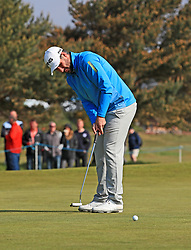 Oliver Farr putts on the 1st green during day three of the Betfred British Masters at Hillside Golf Club, Southport.