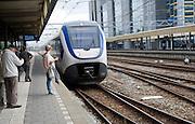 Intercity train to Den Haag Centraal, arriving at platform Leiden Central railway station, Netherlands