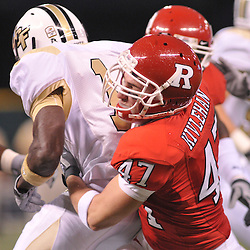 Dec 19, 2009; St. Petersburg, Fla., USA; Rutgers cornerback Patrick Kivlehan (47) tackles UCF wide receiver Quincy McDuffie (14) during NCAA Football action in Rutgers' 45-24 victory over Central Florida in the St. Petersburg Bowl at Tropicana Field.