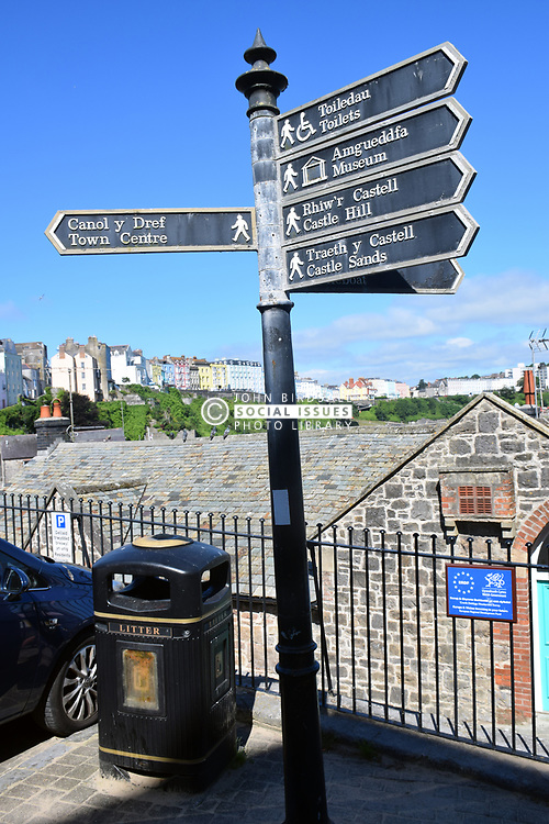 Direction sign in English & Welsh, Tenby, Pembrokeshire South Wales 2021