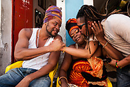 Afro Jhaw, Afro beat musician, and mother Afro Joe in front of the shop of the latter