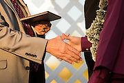 Cal Hills High School seniors shake hands with teachers and school board members before receiving their diplomas during the Class of 2013 graduation at the Milpitas Sports Center in Milpitas, California, on June 6, 2013. (Stan Olszewski/SOSKIphoto)