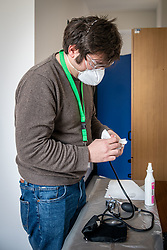 Milan - Coronavirus emergency. USCA Special Continuity Care Units. Dr. Lops visits a quarantined patient at home for being in contact with a positive. The instruments are disinfected before and after each use