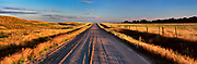Image of an unpaved country road in the Dakota National Prairie Grasslands near Haynes, North Dakota, American Midwest by Randy Wells