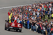 NASCAR Sprint Cup Series driver Jeff Gordon waves to fans before his last race at Kansas Speedway in Kansas City, Kan., Sunday, Oct. 18, 2015. (AP Photo/Colin E. Braley)