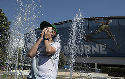 MELBOURNE, Jan. 24, 2019  A spectator plays at a fountain during the 2019 Australian Open in Melbourne, Australia, on Jan. 24, 2019. The Melbourne Park witnessed hot weather here on Thursday. (Credit Image: © Lvxiaowei/Xinhua via ZUMA Wire)