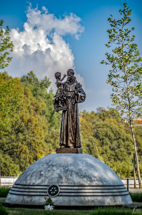 A statue of a saint holding a child in Fatima, Portugal.
