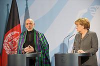 DEU, Deutschland, Germany, Berlin, 06.12.2011: <br />Bundeskanzlerin Angela Merkel (CDU) und der Präsident der Islamischen Republik Afghanistan, Hamid Karzai während einer Pressekonferenz im Bundeskanzleramt in Berlin.