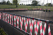 As the UK government's lockdown restrictions during the Coronavirus pandemic continues, and number of UK reported cases rose to 138,078 with a total now of 18,738 deaths, hazard tape marks the closure of a small outdoor play and gym area that has recently become a popular location where users largely ignored the strict social distancing rules while exercising and gathering in Brockwell Park, a public green space in the south London borough of Lambeth, on 23rd April 2020, in London, England.