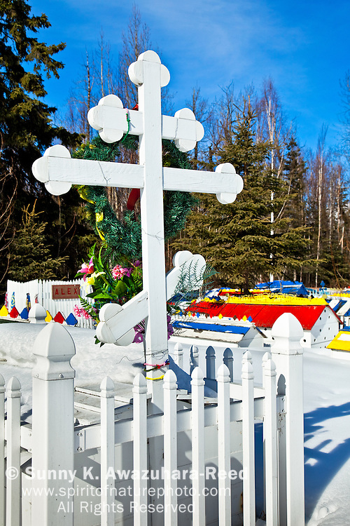 """Colored """"spirit houses"""" on the burial grounds, combined customs of Athabaskan and Russian Orthodox practices, Eklutna Cemetary, Eklutna Village Historical Park, Southcentral Alaska, Winter."""