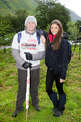 John with the new Miss Scotland Nicola Mimnagh before the start..The John Hartson Foudation walk up Ben Nevis..Pic ©2010 Michael Schofield. All Rights Reserved.