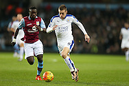 Jamie Vardy of Leicester city ® goes past Idrissa Gana of Aston Villa. Barclays Premier league match, Aston Villa v Leicester city at Villa Park in Birmingham, The Midlands on Saturday 16th January 2016.<br /> pic by Andrew Orchard, Andrew Orchard sports photography.