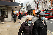 Older people wearing face masks walk along Piccadilly on 25th May 2021 in London, United Kingdom. As the coronavirus lockdown continues its process of easing restrictions, more and more people are coming to the West End as more businesses open.