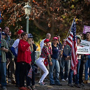 RALEIGH, NC - NOVEMBER 14: A woman fains terror toward a group of anti-racist protestors as a group of supporters of President Donald Trump rally to protest results from the 2020 Presidential election that show a clear victory for President-Elect Joe Biden near the state house in Raleigh, NC on November 14, 2020. Supporters of President Trump are rallying across the country to protest what the the President is calling rampant election fraud perpetrated by the Democratic Party to steal the election for Joe Biden even though there is little evidence to support their claims.  (Photo by Logan Cyrus for AFP)