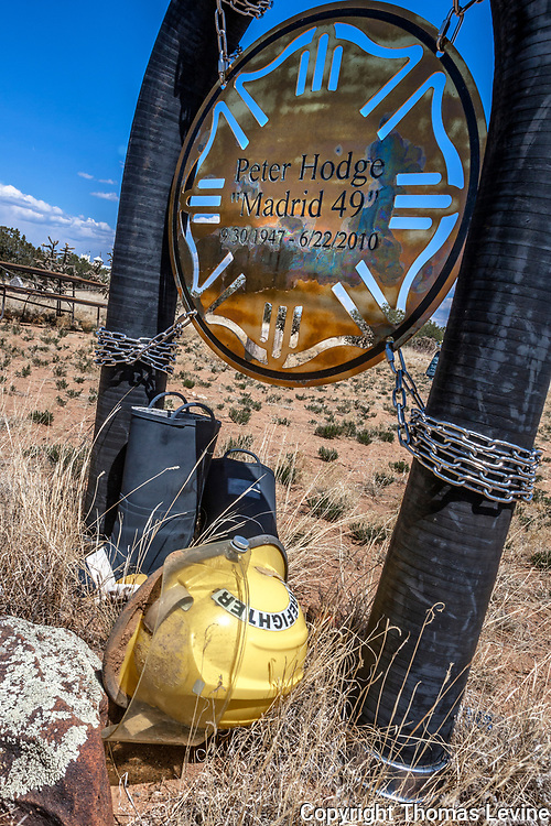 Creative artistic headstone made with chain, a fire helmet and fire hose in Madrid's creative cemetery.