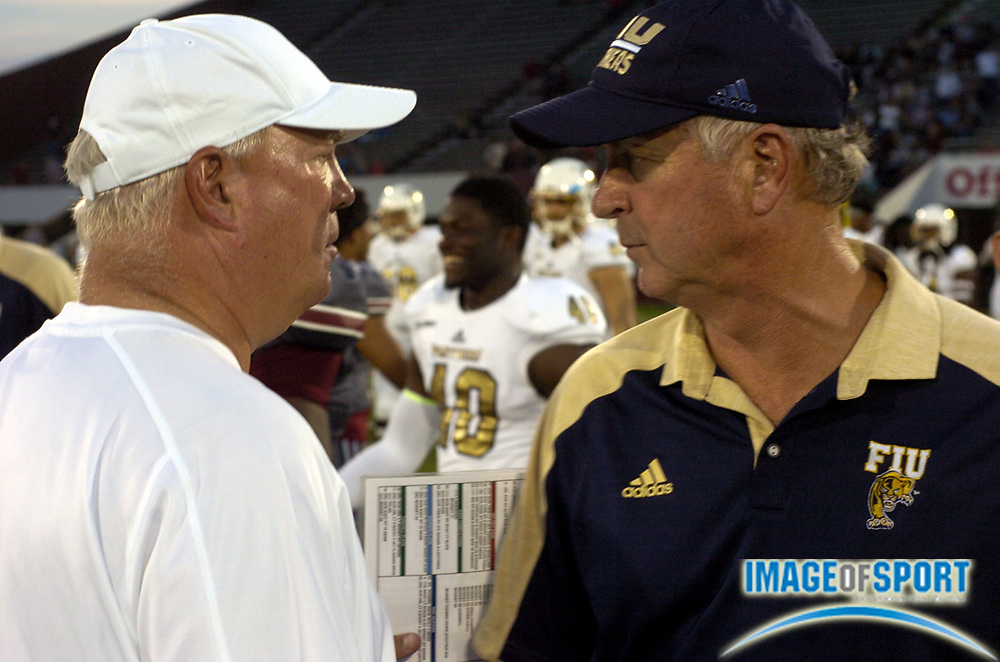Sep 17, 2016; Massachusetts head coach Mark Whipple talks with FIU head coach Ron Turner after a NCAA football game between the Florida International Golden Panthers and the Massachusetts Minutemen at Warren McGuirk Alumni Stadium in Amherst, Mass. Photo by Reuben Canales