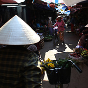 A market scene in Hoi An, Vietnam. Hoi An is an ancient town and an exceptionally well-preserved example of a South-East Asian trading port dating from the 15th century. Hoi An is now a major tourist attraction because of its history. Hoi An, Vietnam. 5th March 2012. Photo Tim Clayton