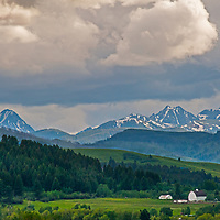 A summer thunderstorm builds over the Spanish Peaks and a ranch in the Southern Gallatin Valley near Bozeman, Montana.