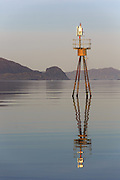 A beacon in the fairway with early morning sun and reflection | Sjømerke i skipsleida med morgenlys og refleksjon. Søre Vaulen