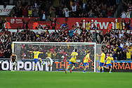 Arsenal players celebrate as Aaron Ramsey (3rd right) scores their 2nd goal. Barclays Premier league, Swansea city v Arsenal at the Liberty Stadium in Swansea on Saturday 28th Sept 2013.  pic by Andrew Orchard, Andrew Orchard sports photography.