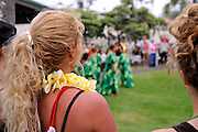 Spectators at the free monthly concert of traditional Hawaiian music and dance at the Hulihe'e Palace, in honour of Hawaiian royalty. Kailua-Kona, Big Island, Hawaii