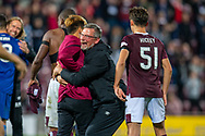 Heart of Midlothian manager Craig Levein hugs Ryotaro Meshino (#77) of Heart of Midlothian FC after Hearts win the penalty shoot out at the end of Betfred Scottish Football League Cup quarter final match between Heart of Midlothian FC and Aberdeen FC at Tynecastle Stadium, Edinburgh, Scotland on 25 September 2019.
