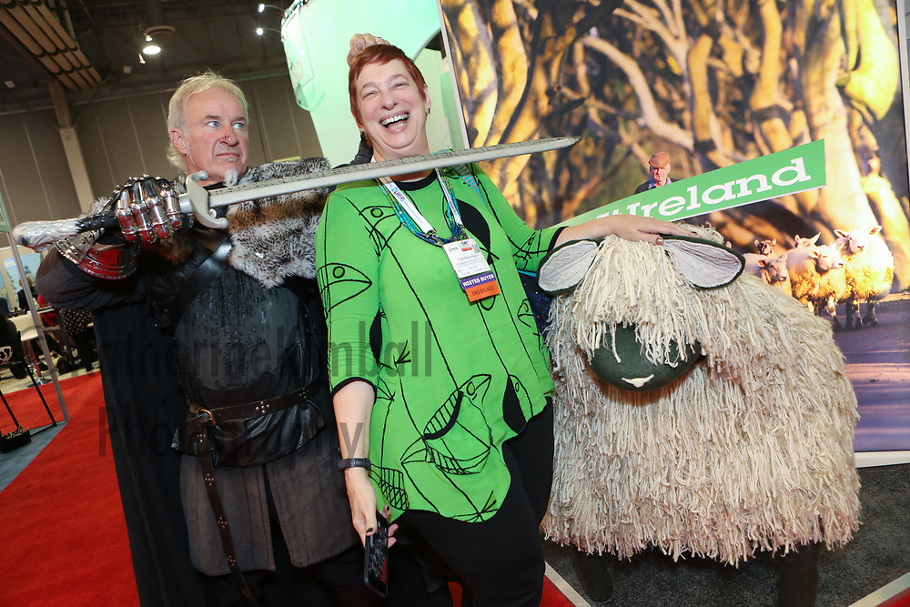 A Hosted Buyer visits the Ireland booth and meets a sword wielding knight at the IMEX America Expo.