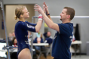 Champlin Park captain Amanda Cunningham high fives coach Jon Wynia after competing during the dual gymnastics meet against Coon Rapids High School at Champlin Park, Friday, January 31, 2014. Champlin Park won the meet with a combined score of 137.35 over Coon Rapids' 125.975.