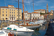 Sailing boats in harbour with Italian style buildings & church. Piran , Slovenia Visit our PHOTO COLLECTIONS OF SLOVANIAN  HISTOIC PLACES for more photos to download or buy as wall art prints https://funkystock.photoshelter.com/gallery-collection/Pictures-Images-of-Slovenia-Photos-of-Slovenian-Historic-Landmark-Sites/C0000_BlKhcYWnT4Sites/C0000qxA2zGFjd_k