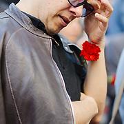 Man holding carnation at April 25th (Carnation Ravolution) protest