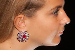 Sotheby's, London, October 20th 2014. Jewels from the famed collection of Dimitri Mavrommatis will be offered in Sotheby's Geneva sale of Magnificent Jewels & Noble Jewels on 12 November. PICTURED: A woman modeld one of the earrings by JAR, Widely acknowledged as being the most talented jeweller of his generation.