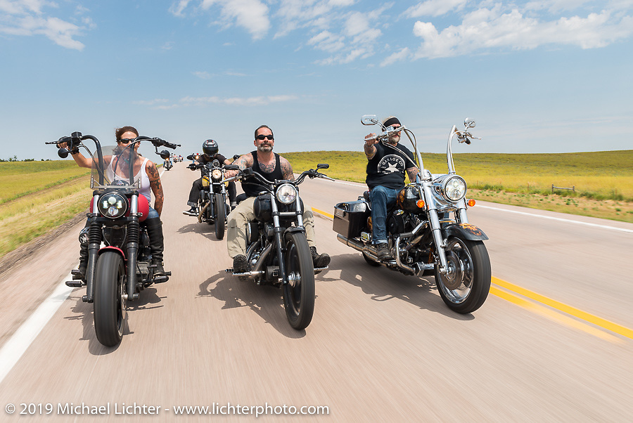 Debi Holmes (L), Ken Herrick (M) and Reed Holmes (R) ride 3-up back to Sturgis after the annual Michael Lichter - Sugar Bear Ride hosted by Jay Allen with the Easyriders Saloon during the Sturgis Black Hills Motorcycle Rally. SD, USA. Sunday, August 3, 2014. Photography ©2014 Michael Lichter.