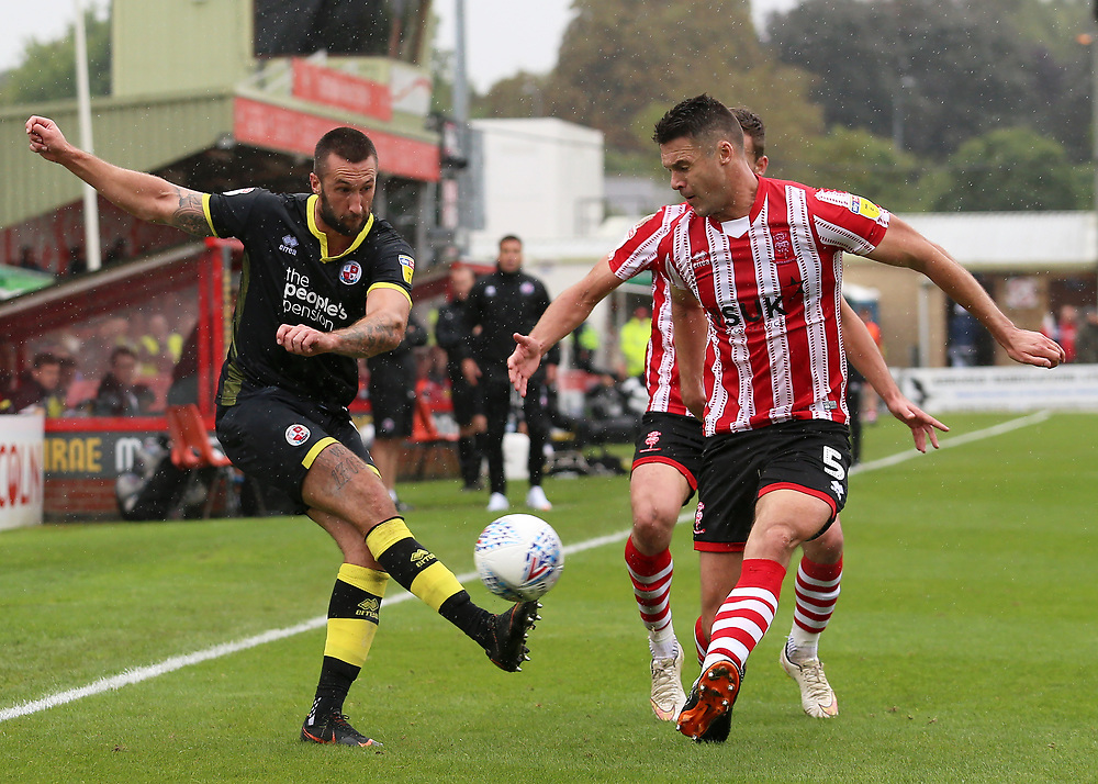 Crawley Town's Ollie Palmer gets a cross in past Lincoln City's Jason Shackell<br /> <br /> Photographer David Shipman/CameraSport<br /> <br /> The EFL Sky Bet League Two - Lincoln City v Crawley Town - Saturday September 8th 2018 - Sincil Bank - Lincoln<br /> <br /> World Copyright © 2018 CameraSport. All rights reserved. 43 Linden Ave. Countesthorpe. Leicester. England. LE8 5PG - Tel: +44 (0) 116 277 4147 - admin@camerasport.com - www.camerasport.com