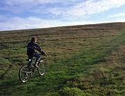 ARM48B Child on country bike ride Burrow Hill Butley Suffolk England