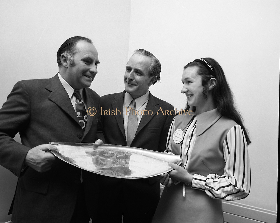 """B.I.M.National Seafood Cook..1972..05.05.1972..05.05.1972..5th May 1972..The final of the """"National Seafood Cook 1972"""" was held in the Great Southern Hotel,Killarney,Co Kerry.The winner was Miss Mary Coleman (14 years)from the Vocational School, Claremorris,Co Mayo.The title of the winning dish was """"Amber Ring. She was chosen from 18 regional finalists...Picture of Mr Jackie Fahy TD,(left),Parliamentary Secretary to the Minister for Agriculture, presenting the Perpetual Challenge Trophy and a cheque fur £150 to the winner Ms Mary Coleman,Claremorris,Co Mayo. Included in the picture is Mr T F Geoghegan,Market Development manager,Bord Iascaigh Mhara (B.I.M.)"""