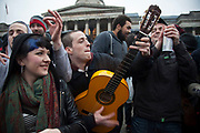 London, UK. Saturday 13th April 2013. Revellers make music and sing along happily for the Margaret Thatcher Death Party in Trafalgar Square, to celebrate the late Prime Minister's passing away.