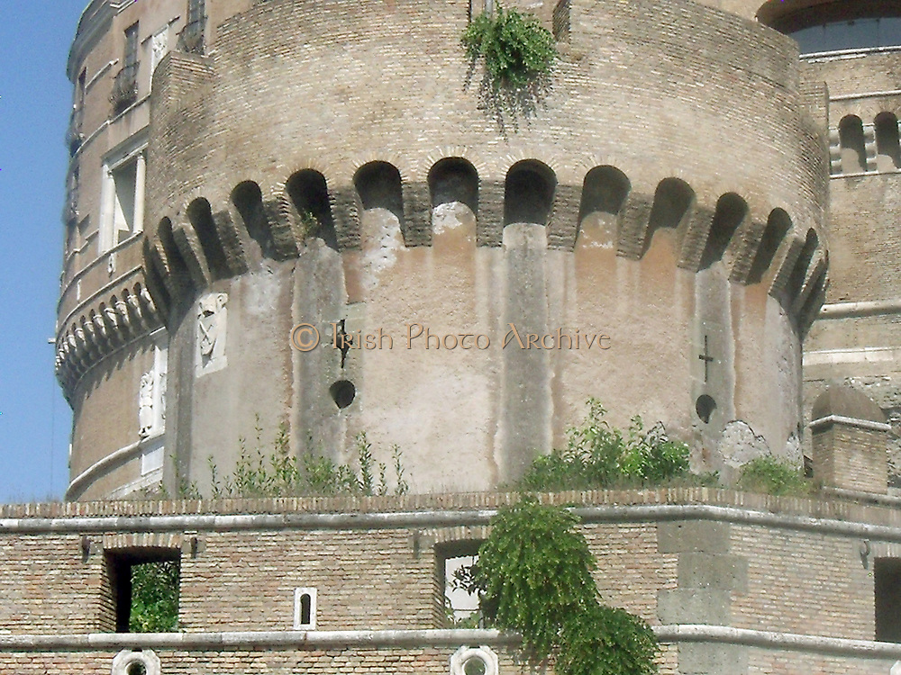 Architectural detail from the Castel Sant'Angelo, a tall cylindrical building in Parco Adriano, Rome, Italy. It which was initially commissioned as a mausoleum by Roman Emperor Hadrian. The Castel was once the tallest building in Rome, and is now is used as a museum. Circa 2nd century AD.