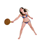 Young woman in a colourful bikini plays racket ball on white background