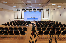 The German press briefing room sits empty just after midnight, waiting for the arrival of Angela Merkel, Germany's chancellor, as the first day of EU Summit meetings stretches into the next day, at the European Council headquarters in Brussels, Belgium on Friday, Dec. 14, 2012. (Photo © Jock Fistick)