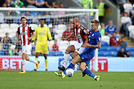 Samir Carruthers of Sheffield United (l) is tackled by Joe Ralls of Cardiff City ®.EFL Skybet championship match, Cardiff city v Sheffield Utd at the Cardiff City Stadium in Cardiff, South Wales on Tuesday 15th August 2017.<br /> pic by Andrew Orchard, Andrew Orchard sports photography.
